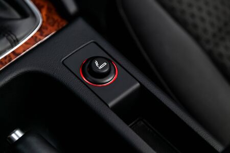 Photo for Close up of the car cigarette lighter socket.modern car interior: parts, buttons, knobs - Royalty Free Image