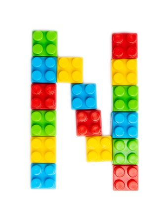 Letter N of the English alphabet  from multi-colored children's plastic constructor on a white isolated background.  Bright alphabet for kids design