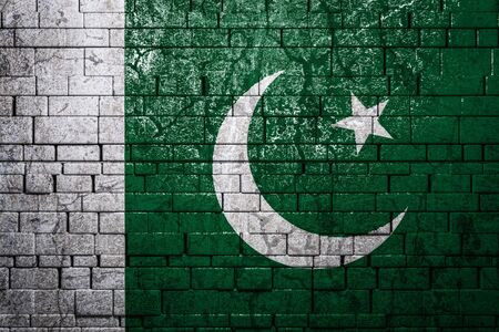 Photo pour National flag of Pakistan on brick  wall background.The concept of national pride and symbol of the country. Flag  banner on  stone texture background. - image libre de droit