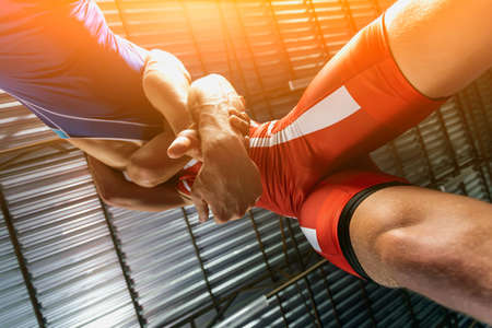 Photo pour Close-up two wrestlers of grappling and greco-roman wrestler in a blue and red tights makes armbar. Submission wrestling - image libre de droit