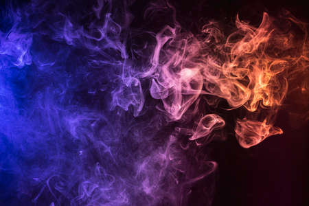 Photo for Frozen abstract movement of explosion smoke multiple colors on black background. Background from the smoke of vape - Royalty Free Image