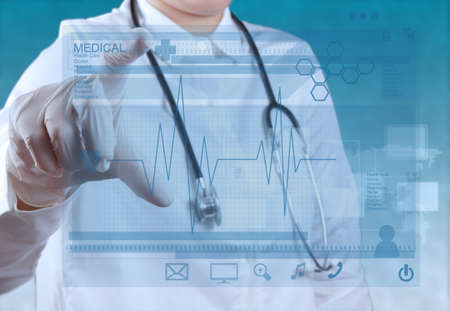 Photo pour Medicine doctor hand working with modern computer interface - image libre de droit