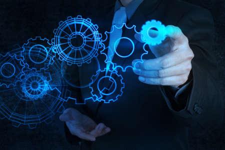 Photo pour businessman hand touch blue gear to success concept - image libre de droit