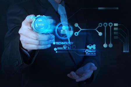 Foto de businessman hand pushing  new technology button on modern computer as concept - Imagen libre de derechos