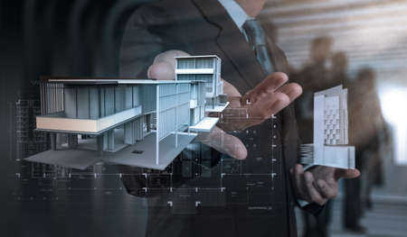 businessman hand presents house model on modern computer as development concept