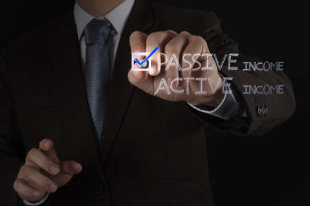 businessman hand checking  passive or acctive income as money concept