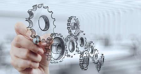 Photo pour businessman hand draws gear to success concept - image libre de droit