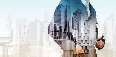 Photo pour Double exposure of business engineer and abstract city as concept - image libre de droit