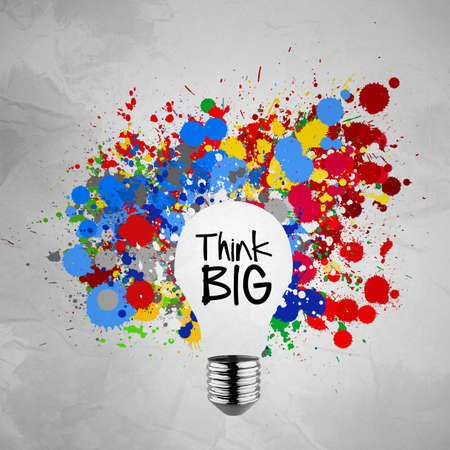 think big word with colorful splash colors lightbulb crumpled paper background as concept