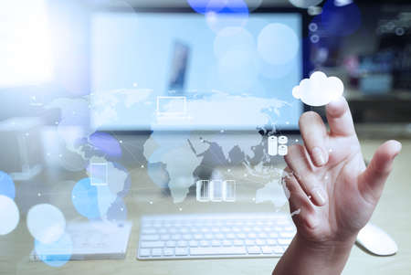 Double exposure of businessman hand working with modern technology as digital cloud concept