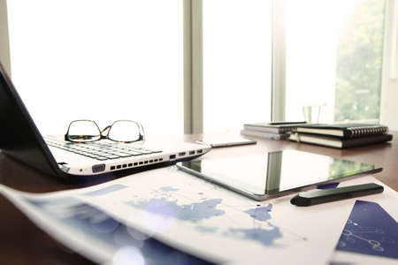 Photo pour business documents on office table with laptop and digital tablet as work space business concept - image libre de droit
