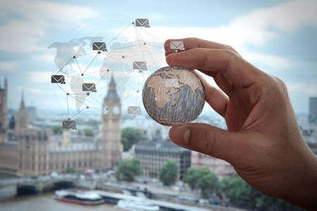 Photo pour close up of businessman hand showing texture the world with digital social media network diagram concept  - image libre de droit