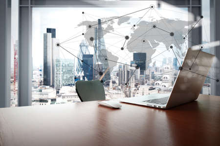 Foto de Office workplace with laptop and smart phone on wood table with london city background with social media diagram - Imagen libre de derechos