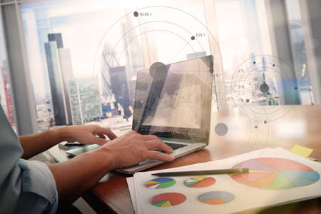 Photo pour business documents on office table with smart phone and laptop computer and graph business with social network diagram and man working in the background - image libre de droit