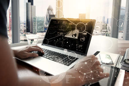 Photo for business documents on office table with smart phone and digital tablet and graph business with social network diagram and man working in the background - Royalty Free Image