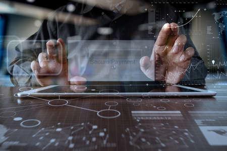 Foto de hands using digital pro tablet with Secure payment on the screen as Online shopping concept - Imagen libre de derechos