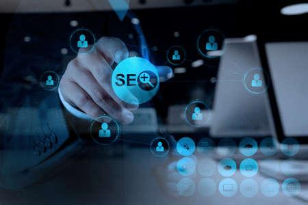Photo pour double exposure of businessman hand showing search engine optimization SEO as concept - image libre de droit