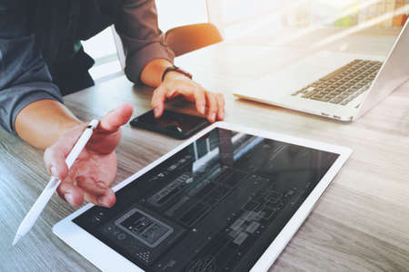 Photo for Website designer working digital tablet and computer laptop and digital design diagram on wooden desk as concept - Royalty Free Image