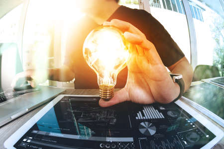 Foto de designer hand showing creative business strategy with light bulb as concept - Imagen libre de derechos
