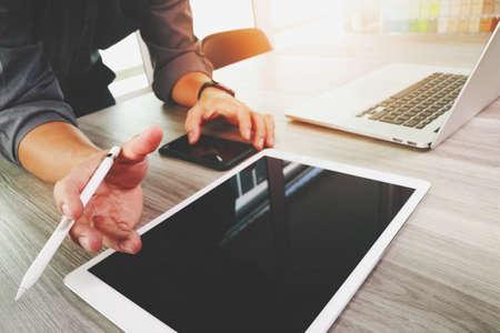Photo pour Website designer working blank screen digital tablet and computer laptop with smart phone on wooden desk as concept - image libre de droit