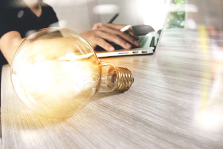Photo for light bulb with designer hand working with laptop computer and creative business strategy as concept - Royalty Free Image