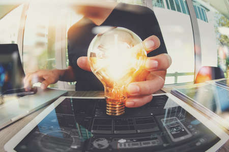 Photo for designer hand showing creative business strategy with light bulb as concept - Royalty Free Image