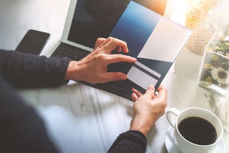 Photo pour Businessperson Hands holding New Gift Card or Credit card,digital tablet computer dock keyboard,smart phone on marble desk,filter effect - image libre de droit