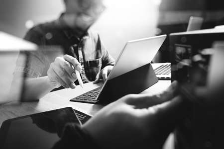 Photo for Website designer working digital tablet and computer laptop with digital tablet and digital design diagram on wooden desk and compact server - Royalty Free Image