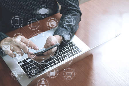 Photo pour top view,business man hand using smart phone,laptop, online banking payment communication network technology 4.0,internet wireless application development sync app,virtual graphic icon diagram - image libre de droit