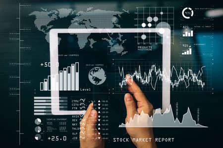 Investor analyzing stock market report and financial dashboard with business intelligence (BI), with key performance indicators (KPI).cyber security internet and networking concept.Businessman hand working with VR.