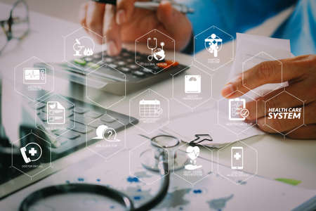 Photo pour Health care system diagram with health check and symptom on VR dashboard.Healthcare costs and fees concept.Hand of smart doctor used a calculator for medical costs in modern hospital  - image libre de droit