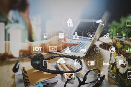 Photo pour Internet of Things (IOT) technology with AR (Augmented Reality) on VR dashboard. Man using VOIP headset with digital tablet computer docking smart keyboard, concept communication, it support, call center  - image libre de droit