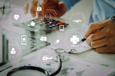Photo pour General Medical Services (GMS) and General Practitioners(GPs or family doctors) diagram.Healthcare costs and fees concept.Hand of smart doctor used a calculator for medical costs in modern hospital - image libre de droit