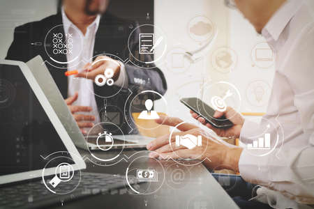 Business process management with workflow automation diagram and gears in virtual flowchart.co working team meeting concept,businessman using smart phone and digital tablet and laptop computer in modern office.
