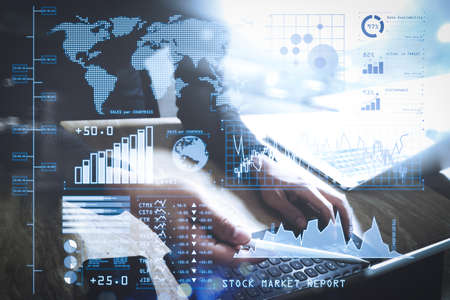 Investor analyzing stock market report and financial dashboard with business intelligence (BI), with key performance indicators (KPI).Website designer working digital tablet dock keyboard and computer laptop with smart phone.