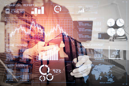 Investor analyzing stock market report and financial dashboard with business intelligence (BI), with key performance indicators (KPI).businessman,designer hand using smart phone,laptop,eyeglasses,online banking payment.