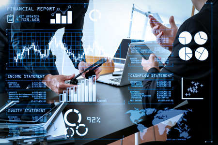 Investor analyzing stock market report and financial dashboard with business intelligence (BI), with key performance indicators (KPI).co working meeting,two businessman using VOIP headset with latop computer.