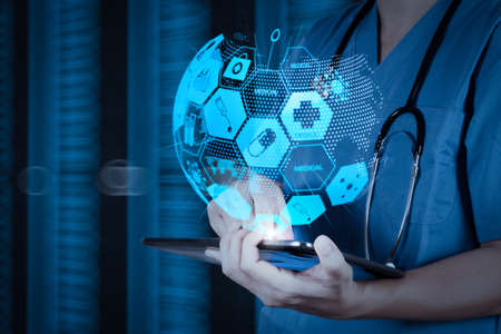 Foto de Health care and medical services concept with world or global form and AR interface.Doctor working on a digital tablet with digital background as concept - Imagen libre de derechos