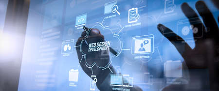 Foto de Developing programming and coding technologies with Website design in virtual diagram.cyber security internet and networking concept.Businessman hand working with VR screen padlock icon on mobile phone. - Imagen libre de derechos