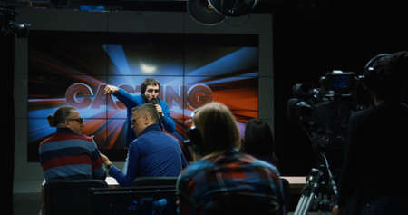 Wide shot of freaky bearded man sang unsuccessfully in front of the jury, and they refused to participate in the show.