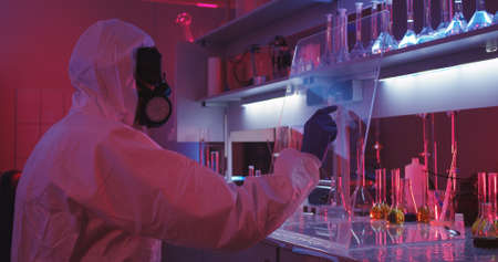 Medium shot of scientist using gesture controlled transparent display in laboratory