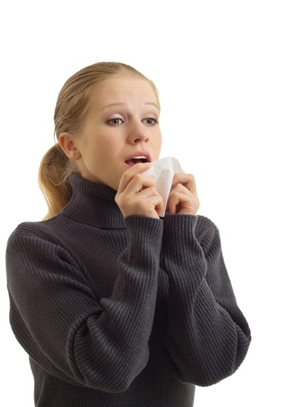 A sneezing woman isolated over white