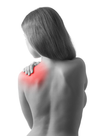 Rear view of  woman holding  shoulder in pain