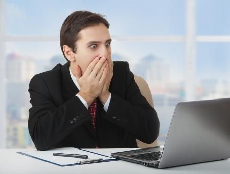 surprised  frightened businessman, laptop,