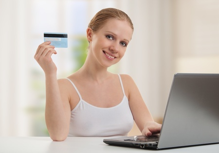 girl with a laptop makes a payment online
