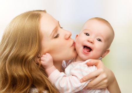 Photo for Happy cheerful family. Mother and baby kissing, laughing and hugging - Royalty Free Image