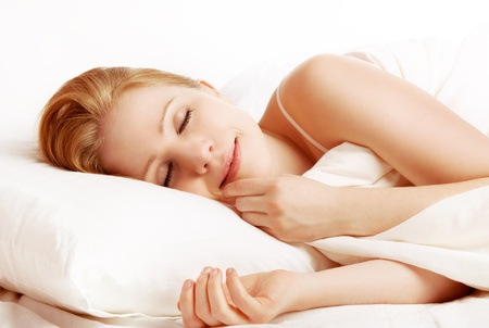 Photo pour young beautiful woman sleeping and smiles in his sleep in  bed  - image libre de droit