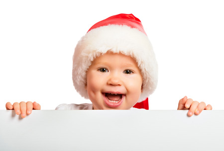 happy baby in a Christmas hat and a blank billboard isolated on white background