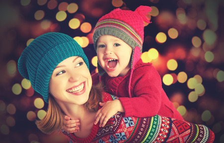 Photo pour happy family mother and baby little daughter playing in the winter for the Christmas holidays - image libre de droit