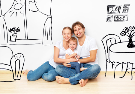 Photo for Concept family: Happy young family in the new apartment dream and plan interior - Royalty Free Image